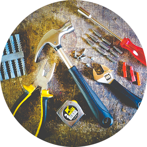 pliers, hammer, nails,screwdriver and measure on the ground